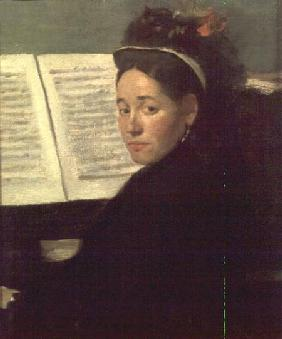 Mademoiselle Marie Dihau (1843-1935) at the piano