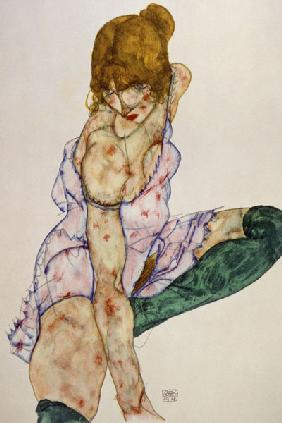Fair-haired girl with green stockings