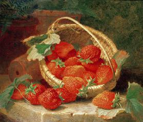 A Basket of Strawberries on a stone ledge
