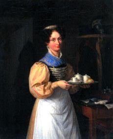 A young Munich waitress in dress and bolt bonnet serves the breakfast