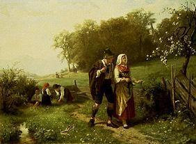 Young alpine couple in spring