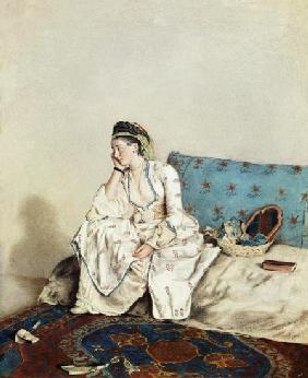 Lady with oriental dress on a Divan
