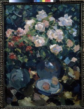 Roses in a blue jug