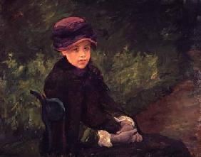 Susan Seated Outdoors Wearing a Purple Hat