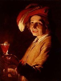 Young man with wine-glass and candle