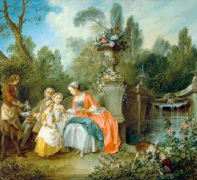 A lady in the garden who drinks coffee with some children