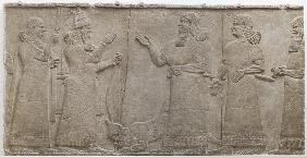 Carved relief of Tiglath-Pileser III receiving homage from a vanquished warrior, south-west palace,