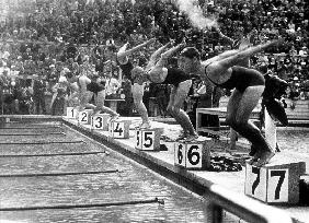 swimming competition at berlin Olympic Games: here swimmers diving in swimmming pool