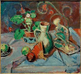 Still life with a white pitcher, plastic, fans and oranges