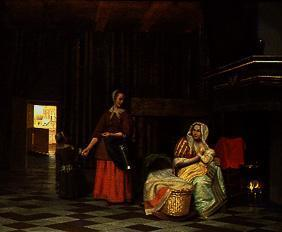 Woman with child at the chest and service maid.