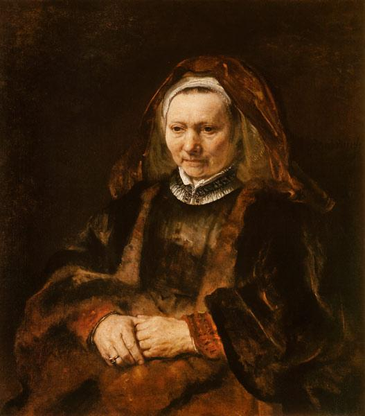 Portrait of an old woman with fanfolded hands
